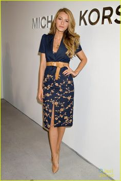 Blake Lively: Michael Kors Show at NYFW in Fawn double breasted coat, indigo short sleeve jacket, raffia embroidered indigo pencil skirt and bandeau with a peanut leather belt.