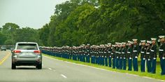 Marines line the road while the funeral procession of Medal of Honor recipient COL Bud Day passes by.