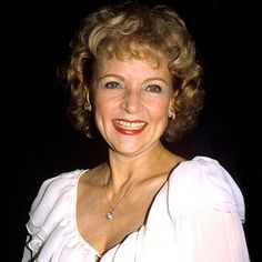 1982   Betty White   Blond bouffant, red lips, big smile—at 60, the Match Game star embraced her look.