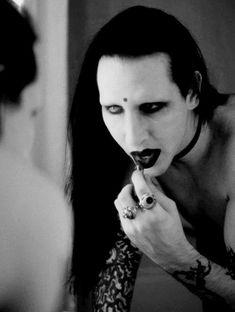 Ahh, watching a man put on black lipstick, I miss it