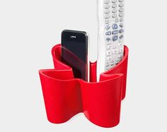 If you're always losing the remote or your cell phones deep within the couch cushions, check out this cute, modern remote control holder from MOMA. It'll help you keep track of multiple remotes, phones, or anything you can think to put in there — while adding a bright splash of color to your living room.