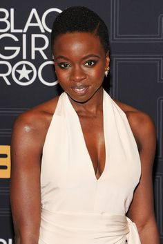 """Danai Gurira, from the cast of """"The Walking Dead,"""" rocks her signature low cut Pixie with a side slit"""