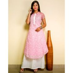 Chikankari love! Pure cotton kurti top in baby pink with chikankari embroidery. Paired with a white palazzo pants. Fusion wear frenzy at dvibgyor.com #ethnicfusion #cotton #chikankari #palazzo #embroidery #pink #kurtitop #kurtidesigns #dvibgyor #designer