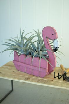 recycled wooden flamingo planter Brighten up your front or backyard with this funky planter! Place your favorite large succulents or plants into this groovy flamingo and show him off at a summer party! Flamingo Party, Flamingo Craft, Flamingo Decor, Flamingo Garden, Pink Flamingos, Yard Flamingos, Wood Projects, Woodworking Projects, Craft Projects