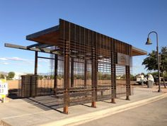 Student-built bus shelters offer shade and water harvesting. #UA #architecture