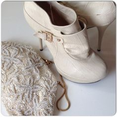 """IN NEW CONDITION IVORY FAUX SNAKESKIN ANKLE BOOTS Chic ivory faux snakeskin ankle boots with side zipper and a bit of slouch. Rounded toe, approximate 4.5"""" heel, platform & GHW make these great for the summer with the right styling!  I paired them with a vintage ivory beaded bag!  I love the textures & blending of eras! These are in new condition size 8 with a tiny spot of glue along one seam which can be removed!! Shoes Heeled Boots"""