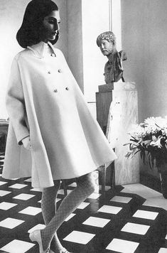 Benedetta Barzini in Fabiani's white tent coat, being admired by sculpted bust. Photo by Henry Clarke for Vogue, 1968.