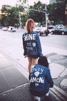 Friends wearing Shop JayDee denim jacket with back art text