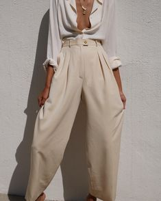 "Stunning vintage Chanel wide leg wool/twill pleated trousers. Such a special find 28"" waist $250 Vintage 100% silk cream button down blouse. Amazing draping (see full shirt shot in our stories) Size s/m $48 SHIRT SOLD"