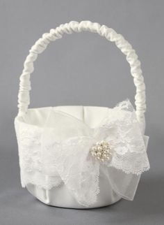 Delilah Flower Girl Basket - Satin basket available in white or ivory. Decorated with a band of lace, a lace bow, a tulle bow, and a cluster of pearls and rhinestones.