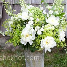 The in-season white and green flowers looked the part, arranged in these tall galvanized tin buckets.