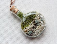 Terrarium Necklace with pearl  Moss Vial by Woodii on Etsy, $40.00.