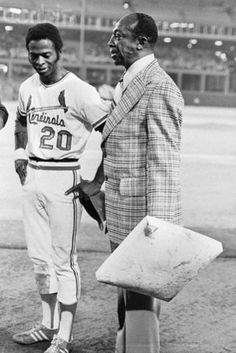 September 10, 1974 - Lou Brock steals his 105th base of the season breaking Maury Wills' single season record. Presenting Lou with the base is Cool Papa Bell.