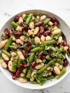 This super simple three bean salad makes the perfect side dish for any quick weeknight meal, BBQ, or potluck. 3 Bean Salad, Three Bean Salad, Bean Salad Recipes, Lunch Recipes, Healthy Recipes, Summer Side Dishes, Side Dishes Easy, Side Dish Recipes, Main Dishes