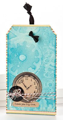 apply distress ink to cardstock with foam applicator then spray a stamp with water and stamp onto the paper