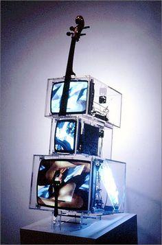 Nam June Paik - TV,  cello, acrylic box, TV monitor, DVD player, cello string,  1999