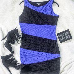 NWOT  blue & black stripe body-con dress NWOT  blue & black stripe body-con dress; ruched and very flattering! Forever 21 Dresses Mini