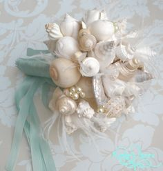 Unique beach theme wedding bouquet.  Like the wrap not sure about the shells