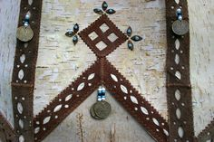 Even people decorate the walls of their dwellings with birch bark, beads and coins