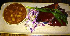 ancho & apricot pork ribs with baked beans and cole slaw at West of Pecos in San Francisco