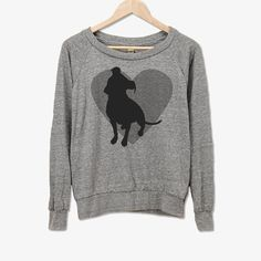 """This original design is printed on a slightly cropped, light-weight American Apparel Slouchy pullover - It's sure to be a new comfy """"go to"""" shirt for any pet lover. ▶︎ Sizing / Fit  Please see the second image above for measurements. A woman weighing 140 lbs wears a size medium with a relaxed fit. This shirt runs a little on the small side so if you are unsure, please order the next size up. This is a shorter cut which looks awesome with high-waisted jeans, yoga pants or leggings. ▶︎ Is ..."""