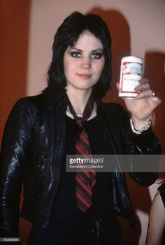 Joan Jett of the rock group The Runaways pose for a portrait before performing at the Masonic Auditorium on January 14, 1978 in Detroit, Michigan.