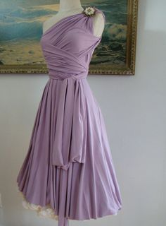 Convertable bridesmaid dress. Bridesmaids can drape and wrap the top to whatever flatters them best.