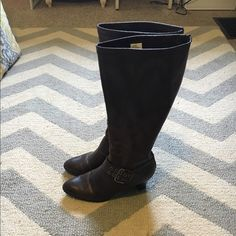 brown tall heeled boots with buckle detail Only worn a few times. Great condition. Fun buckle detail. Zips up the back. Size 10W Fashion Bug Shoes Heeled Boots