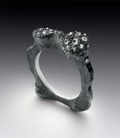 "Ring | Todd Pownell.  ""Amorphous form"" Silver with inverted and bead set diamonds"