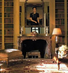 A portrait of the Duchess of Windsor is reflected in the mirror in the library. The needlepoint rug covers the entire room and extends all the way to the base of the fireplace. Source: Pinterest Celebrity Rugs via Royal Places.