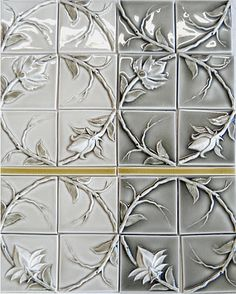 vine flower tiles in two beautiful gray colorways with a golden yellow liner
