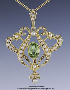 Presented is a beautiful Victorian or Edwardian 15 karat gold pendant, set with a peridot and seed pearls, from circa 1890-1910. The peridot is a gorgeous light green and is very nicely cut, and the pearls are very well chosen to graduate in size and match in color, and are natural pearls given the time period of the piece.
