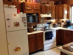 An Update on Painted Kitchen Cabinets and Counter Tops We've had so many people wondering lately about painting their kitchen cabinets and wondering about outdated counter tops, I thought I'd write a post documenti… Diy Kitchen Cabinets, Painting Kitchen Cabinets, Kitchen Paint, Rustic Cabinets, Kitchen Remodeling, Antique Cabinets, Kitchen Counters, Kitchen Tile, Wood Cabinets