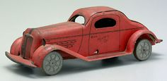 "Toy ""Mystery"" car, trunk marked ""Press Down Here"", pressing down makes car go, 1930s style sedan"