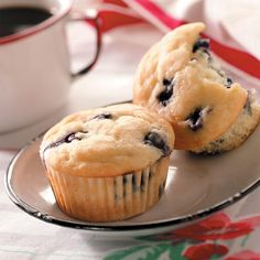 Blueberry Yogurt Muffins Recipe -With the addition of vanilla yogurt, this basic muffin turns out moist and tender. It's easy and quick to prepare. My husband loves these muffins for breakfast on mornings when he is rushing out the door. —Cindi Budreau, Neenah, Wisconsin