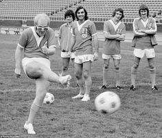 Sir Elton John is seen here showing off his football skills to George Best in 1976. Singing superstar John was a part-owner of North American League team Los Angeles Aztecs at the time and former Manchester United great Best had recently joined the club, for whom he made 23 appearances that year. After playing with Fulham for a season, he played again in California in 1977 and 1978. Elton has always been a keen football fan and became chairman of Watford in 1976