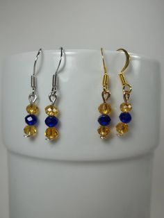 Support your team with these blue and gold earrings from my #etsy shop: #Blue & Gold #jewelry #mountaineerearrings #wvumountaineers #goldandblue #mountaineer #westvirginia #wvu #wv #mountaineerjewelry #shopsmall #westvirginiabusiness #designsbydeirdreshop #mountaineerfan #giftidea