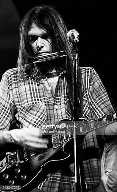 Neil Young performs on stage at Hammersmith Odeon London 28th March 1976 He plays a Gibson Les Paul guitar