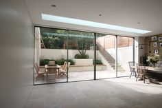 Bi Parting Minimal Windows Sliding Doors with above frameless rooflight by IQ Glass
