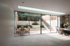 Bi Parting Minimal Windows Sliding Doors with above frameless rooflight by IQ Glass