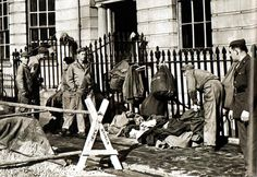 American soldiers stationed in the London area help in the rescue work during a German air raid on the city - 1944