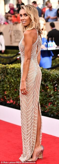 Bronzed beauty: The 42-year-old TV star stunned in a jeweled halterneck gown and beachy blonde wave