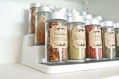 150 Dollar Store Organizing Ideas and Projects for the Entire Home Spice Organization and Printables - If you want your spices to be a bit more organized, you can pick up small containers for about a dollar (this gives you 3 of them). Just add your spices to the containers and then print out labels to keep them all looking good and so that you know which spice is in which jar.