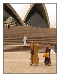 """Buddist Monks at the Sydney Opera House"" by Flickr user Kent Johnson"