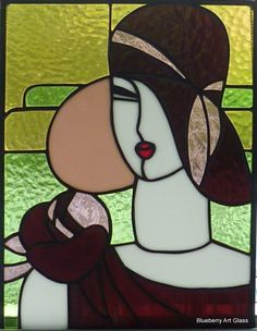 Beautiful Art Deco lady stained glass panel in shades of pink, green, purple and white glass.
