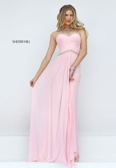 Make enchanting moments to remember in the Sherri Hill 50442 full-length prom dress. This gorgeous gown showcases a ruched surplice sweetheart bodice below a brilliantly bead embellished jewel neckline. Illusion cap sleeves extend into the upper illusion back. An inverted band of beads accentuates the waistline above the cascading, lightly gathered layers of the A-line skirt with sweep train.