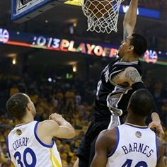 5087abadf6d Danny Green dunks over Stephen Curry and forward Harrison Barnes during the  first quarter of Game 4 of the 2013 Western Conference semifinal
