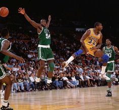 Celtics, Oct, 22 1991 Lakers point guard Magic Johnson tosses a no-look pass past Celtics forward Ed Pinckney during a preseason game. About two weeks later, Johnson announced he was HIV-positive and retiring from basketball. Sport Basketball, Love And Basketball, Basketball Legends, Basketball Players, Basketball Diaries, Celtics Basketball, Basketball History, Basketball Season, Lakers Vs Celtics