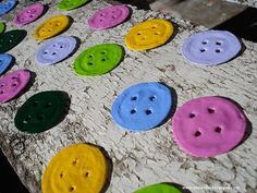"""These little metal """"buttons"""" are actually old beer bottle caps, hammered, painted and pierced.  Hmm.....so many uses. You could forgo the button holes, just put one and decopage or paint for a necklace. A great idea for the girls...especially after one of dad's """"speaker receptions""""."""