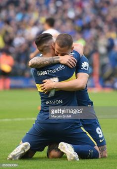 Cristian Pavon of Boca Juniors celebrates with teammate Dario Benedetto after scoring the first goal of his team during a match between Boca Juniors and Chacarita as part of Superliga at. Get premium, high resolution news photos at Getty Images Football Soccer, Football Players, International Teams, World Of Sports, Gay Couple, Fifa, Sexy Men, Guys, Celebrities